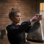 Rosamund Pike Glows as Marie Curie in Curious Biopic